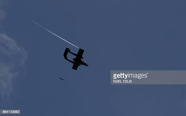 An OV10 Bronco aircraft drops a bomb against Islamits militants hideout in Marawi on the southern Philippine island of Mindanao on June 9 2017 More...