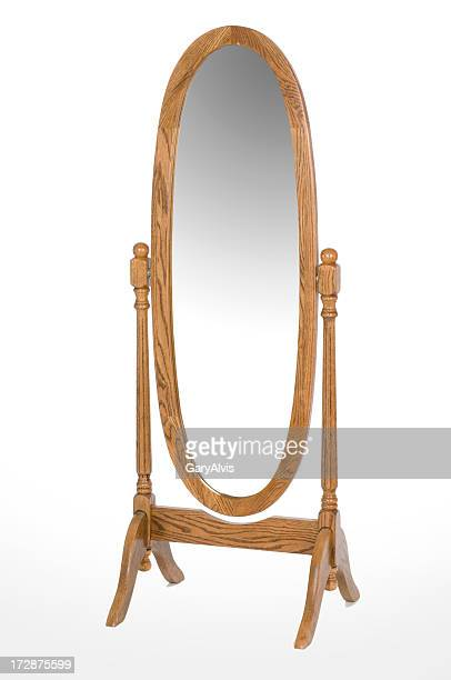 An oval oak full length mirror
