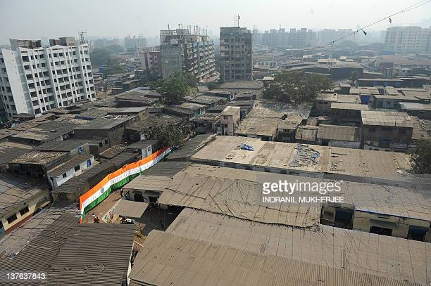 An over 150 feet long hand made Indian national flag is hung in one of the narrow bylanes of the Dharavi slum in Mumbai on January 24 2012 The giant...