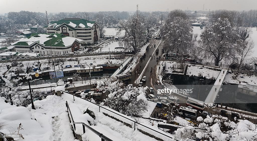 An over view of snow covered buildings after snowfall on January 01, 2014 in Srinagar, the summer capital of Indian Administered Kashmir, India. Weather conditions have improved in Kashmir after a spell of heavy snowfall that had distrupted road and air traffic, cutting off the Valley from the rest of world .