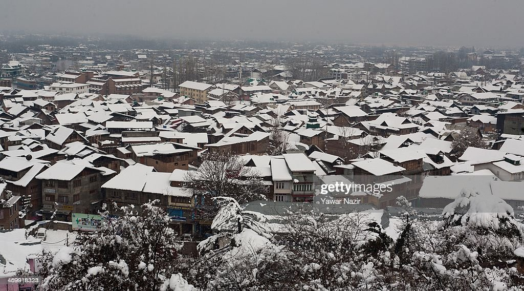 An over view of snow covered residential houses after snowfall on January 01, 2014 in Srinagar, the summer capital of Indian Administered Kashmir, India. Weather conditions have improved in Kashmir after a spell of heavy snowfall that had distrupted road and air traffic, cutting off the Valley from the rest of world .