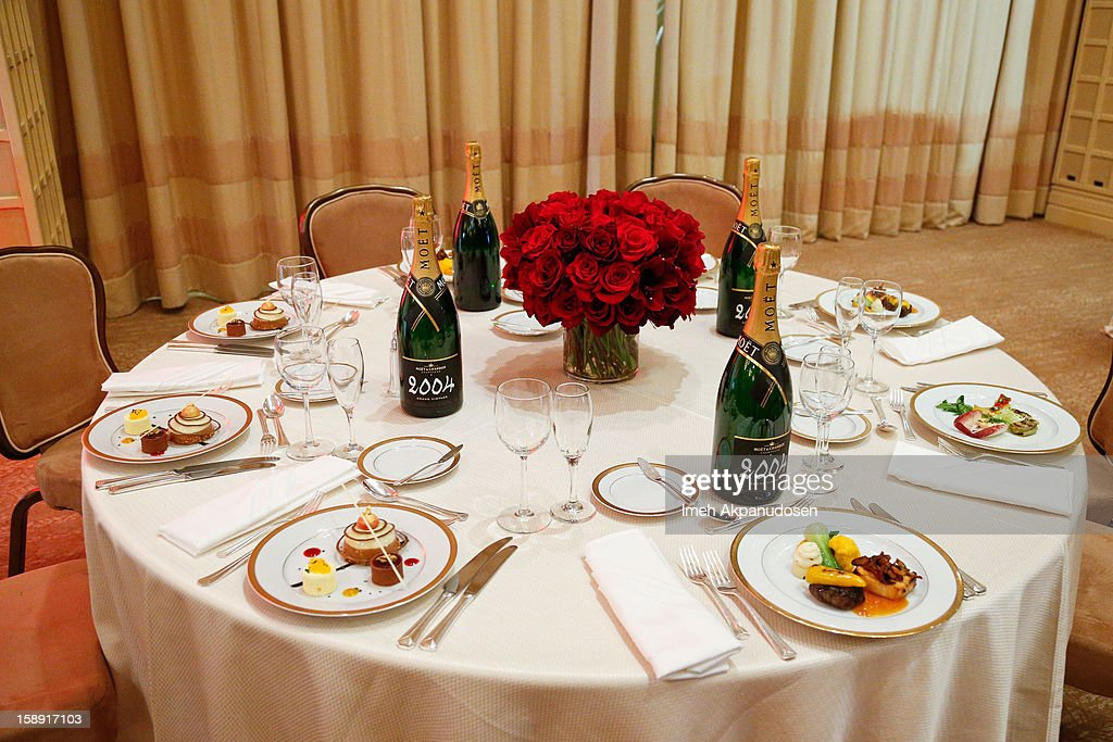 An overall view of table setting with the appetizer, entree and dessert prepared by executive chef Suki Sugiura and executive pastry chef Thomas Henzi for the 2013 Golden Globe Awards at The Beverly Hilton Hotel on January 3, 2013 in Beverly Hills, California.