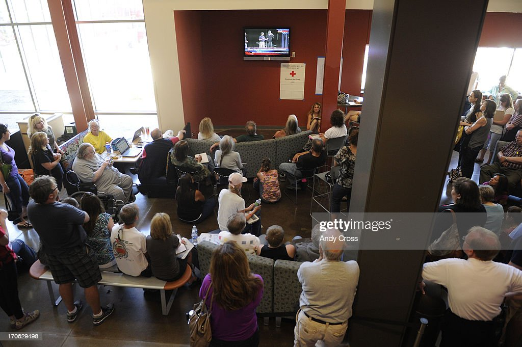 An overflow crowd gathered to watch a television feed during a community meeting for Black Forest fire evacuees at Palmer Ridge High School Saturday morning, June 15, 2013. The fire is 45% contained, but has claimed two lives and over 450 homes.