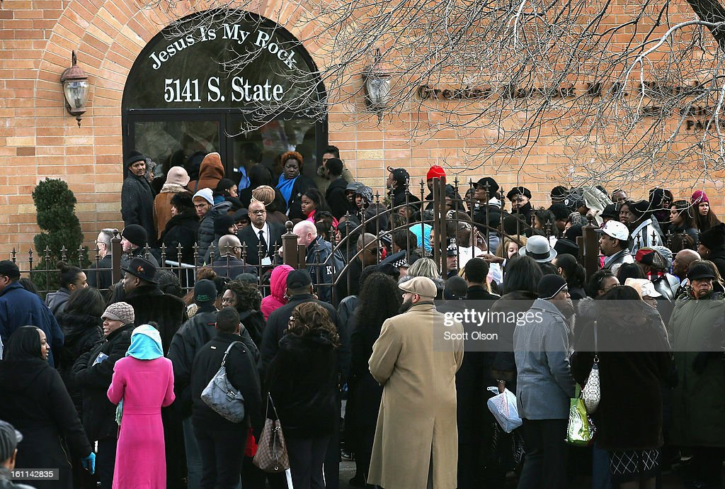 An overflow crowd stands outside the Greater Harvest M.B. Church during the funeral of 15-year-old Hadiya Pendleton on February 9, 2013 in Chicago, Illinois. Hadiya was killed on January 29, when a gunman opened fire on her and some friends while they were standing under a shelter on a warm rainy afternoon in a park about a mile from President Obama's Chicago home. First lady Michelle Obama attended the funeral with Senior White House Adviser Valerie Jarrett and Secretary of Education Arne Duncan.