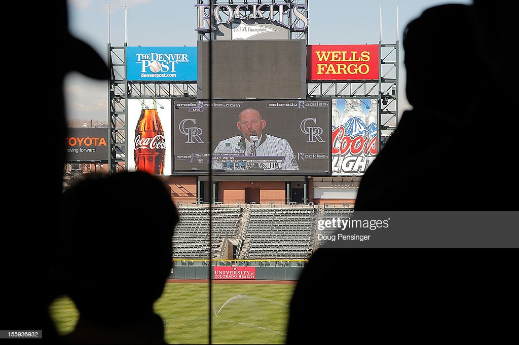 An overflow crowd watches the broadcast on the scoreboard as <a gi-track='captionPersonalityLinkClicked' href=/galleries/search?phrase=Walt+Weiss&family=editorial&specificpeople=239045 ng-click='$event.stopPropagation()'>Walt Weiss</a> was named the manager of the Colorado Rockies during a press conference at Coors Field on November 9, 2012 in Denver, Colorado.