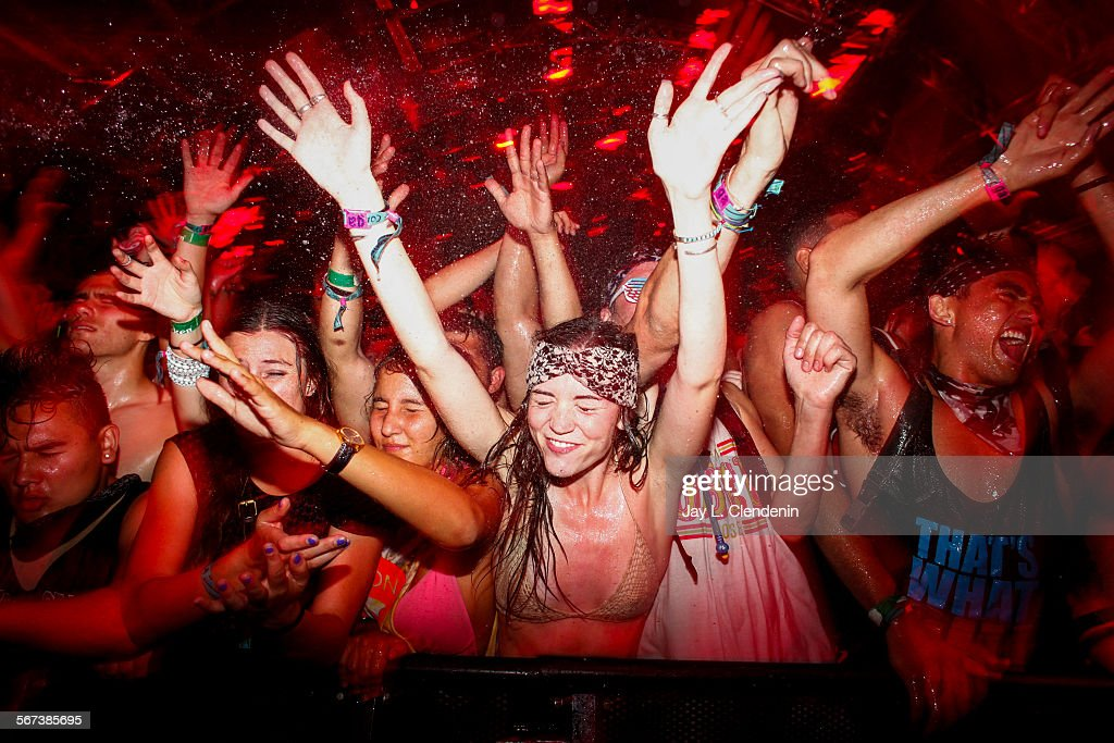 INDIO CA APRIL 19 2014 An overflowing crowd inside the Sahara Tent celebrates the DJ known as Skrillex on the second day of the second weekend of the...