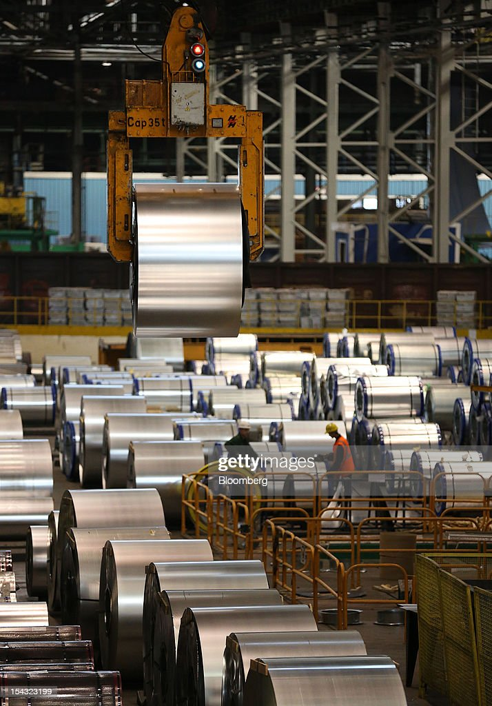 An overhead crane positions galvanised steel rolls after manufacture at the OAO Novolipetsk Steel plant, also known as NLMK, in Lipetsk, Russia, on Wednesday, Oct. 17, 2012. OAO Novolipetsk Steel, controlled by billionaire Vladimir Lisin, became Russia's largest steelmaker by output after boosting production by 24 percent. Photographer: Andrey Rudakov/Bloomberg via Getty Images