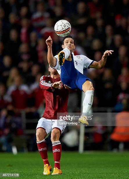 An overhead kick from Cedric of Portugal in front of Michael KrohnDehli of Denmark during the UEFA 2016 Group I Qualifier between Denmark and...