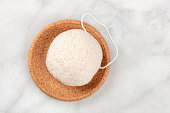 An overhead photo of a natural biodegradable Konjac sponge, shot from the top with a place for text