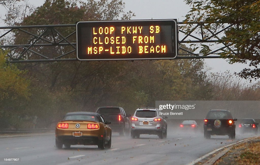 An overhead sign on the Southern Parkway alerts motorists to road closings as high tide and winds from Hurricane Sandy combine to flood the area on October 29, 2012 in Wantagh, New York. The storm, which threatens 50 million people in the eastern third of the U.S., is expected to bring days of rain, high winds and possibly heavy snow.
