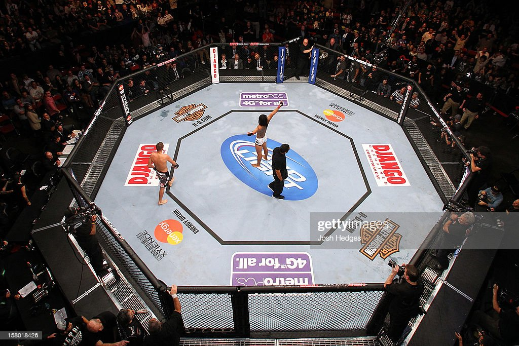 An overhead view as Benson Henderson (white shorts) salutes the crowd after his bout against Nate Diaz during the UFC on FOX event on December 8, 2012 at Key Arena in Seattle, Washington.