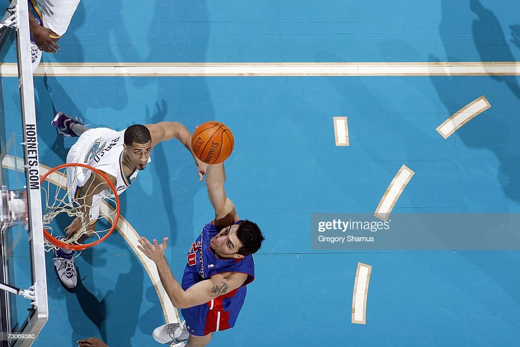 An overhead view as Carlos Delfino #20 of the Detroit Pistons puts up the shot against Jannero Pargo #2 of the New Orleans/Oklahoma City Hornets on January 4, 2007 at the Ford Center in Oklahoma City, Oklahoma.