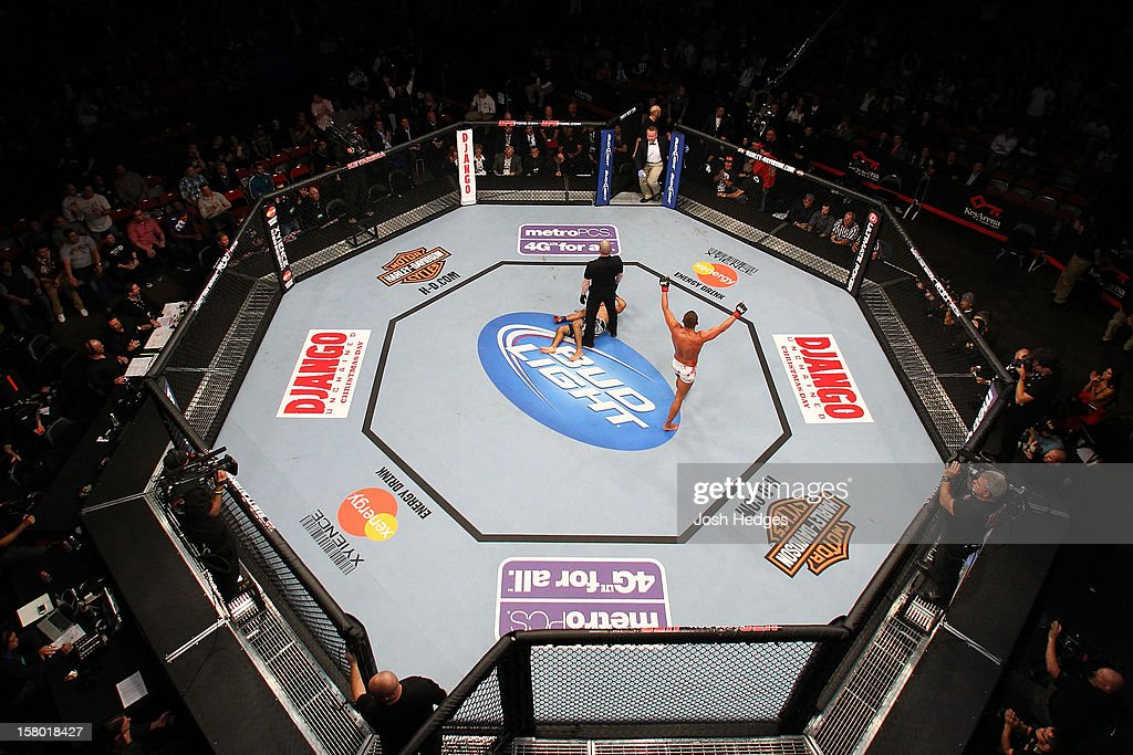 An overhead view as Daron Cruickshank (white shorts) reacts after knocking out Henry Martinez during the UFC on FOX event on December 8, 2012 at Key Arena in Seattle, Washington.