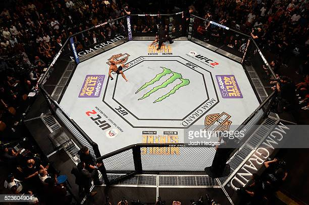 An overhead view as Demetrious Johnson celebrates his victory over Henry Cejudo in their flyweight championship bout during the UFC 197 event inside...