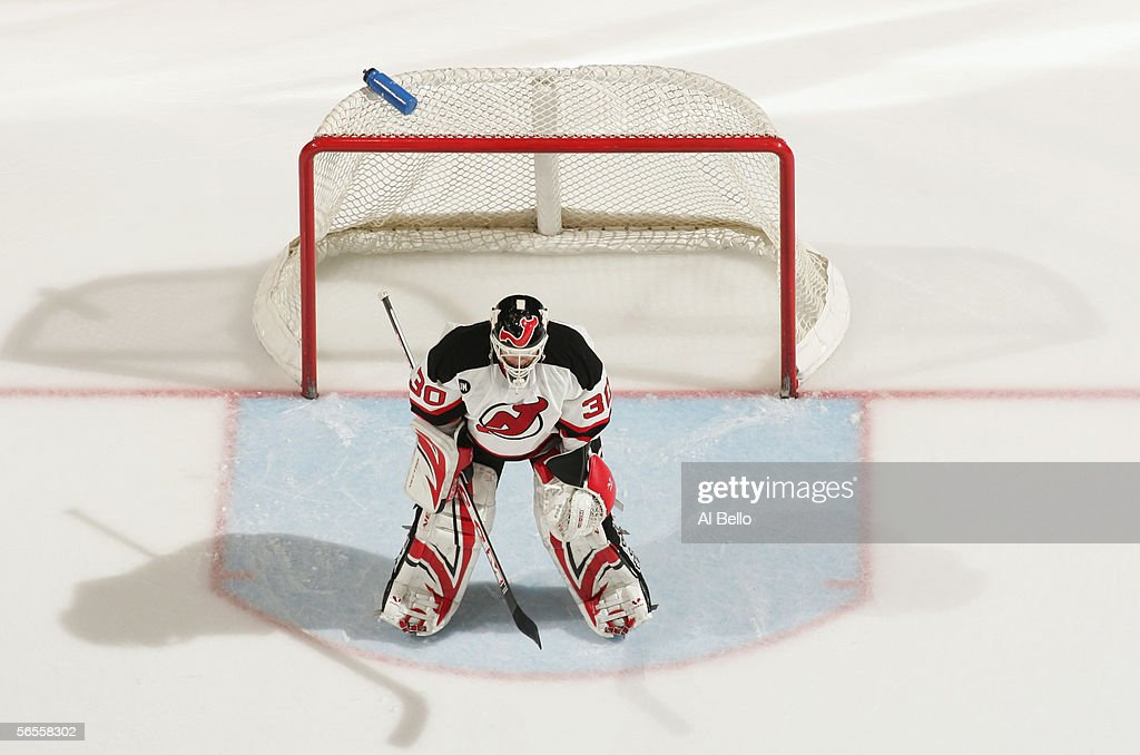 An overhead view as goaltender Martin Brodeur of the New Jersey Devils follows the puck during the game against the New York Islanders on December 21...