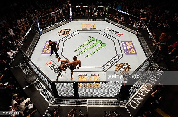 An overhead view of Jon Jones kicking Ovince Saint Preux in their interim UFC light heavyweight championship bout during the UFC 197 event inside MGM...