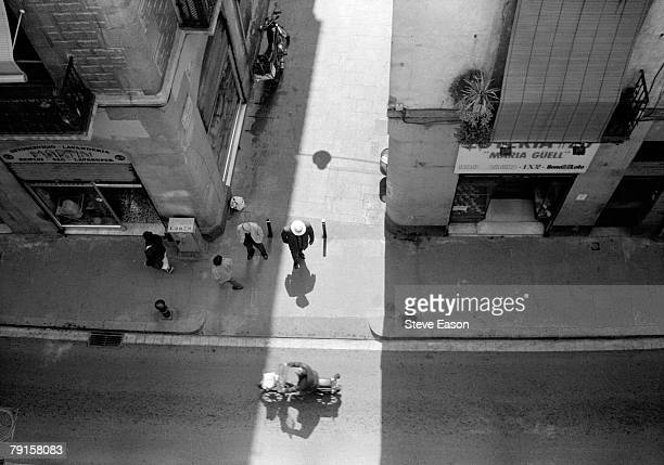 An overhead view of passersby in a Barcelona street Spain 1992
