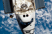 March 12, 2008 - An overhead view of the exterior of Space Shuttle Endeavour's crew cabin, part of its payload bay doors and docking system was provided by Expedition 16 crewmembers on the Internation