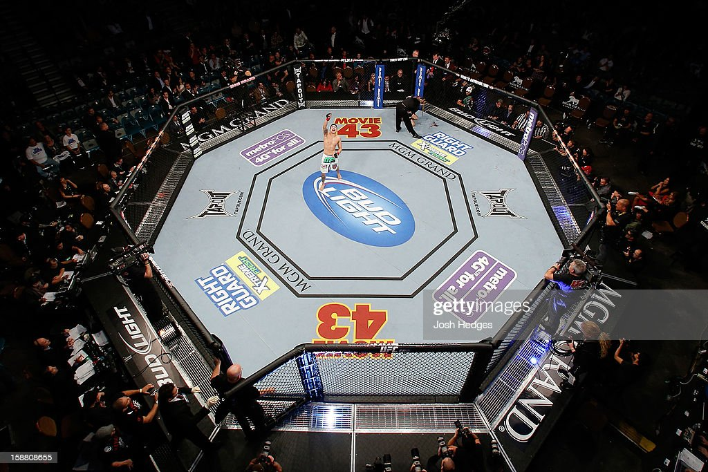 An overhead view of the Octagon as Erik Perez (white shorts) reacts after defeating Byron Bloodworth during their bantamweight fight at UFC 155 on December 29, 2012 at MGM Grand Garden Arena in Las Vegas, Nevada.