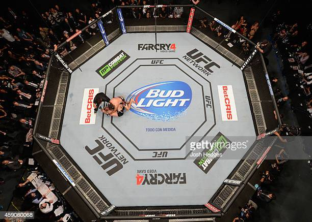 An overhead view of the Octagon as Fabricio Werdum knocks out Mark Hunt in their interim UFC heavyweight championship bout during the UFC 180 event...