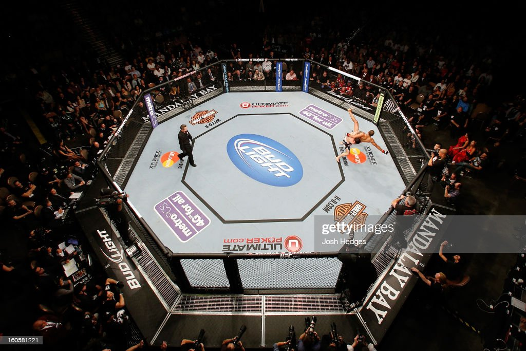 An overhead view of the Octagon as Frankie Edgar (L) takes down Jose Aldo during their featherweight title fight at UFC 156 on February 2, 2013 at the Mandalay Bay Events Center in Las Vegas, Nevada.