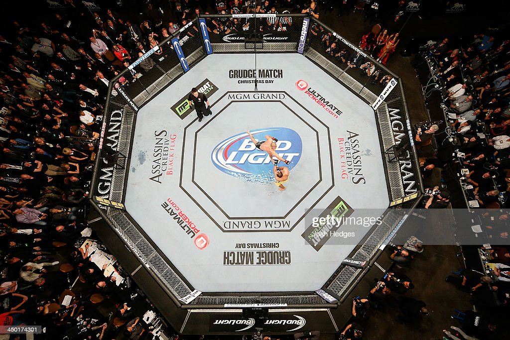 An overhead view of the Octagon as <a gi-track='captionPersonalityLinkClicked' href=/galleries/search?phrase=Georges+St-Pierre&family=editorial&specificpeople=4864241 ng-click='$event.stopPropagation()'>Georges St-Pierre</a> (black shorts) punches Johny Hendricks (yellow shorts) during their welterweight championship bout during the UFC 167 event inside the MGM Grand Garden Arena on November 16, 2013 in Las Vegas, Nevada.