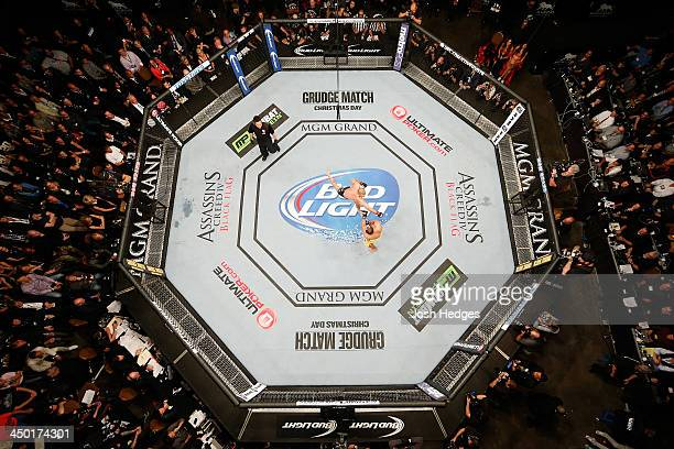 An overhead view of the Octagon as Georges StPierre punches Johny Hendricks during their welterweight championship bout during the UFC 167 event...