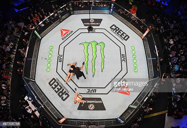 An overhead view of the Octagon as Holly Holm celebrates after her knockout victory over Ronda Rousey in their UFC women's bantamweight championship...