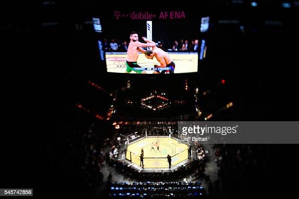 An overhead view of the Octagon as Johny Hendricks punches Kelvin Gastelum during the UFC 200 event on July 9 2016 at TMobile Arena in Las Vegas...