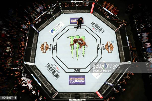 An overhead view of the Octagon as Jon Jones punches Daniel Cormier in their light heavyweight championship bout during the UFC 214 event at Honda...