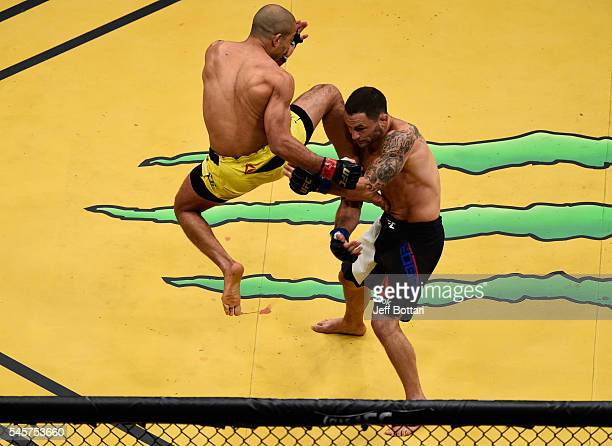 An overhead view of the Octagon as Jose Aldo of Brazil knees Frankie Edgar during the UFC 200 event on July 9 2016 at TMobile Arena in Las Vegas...