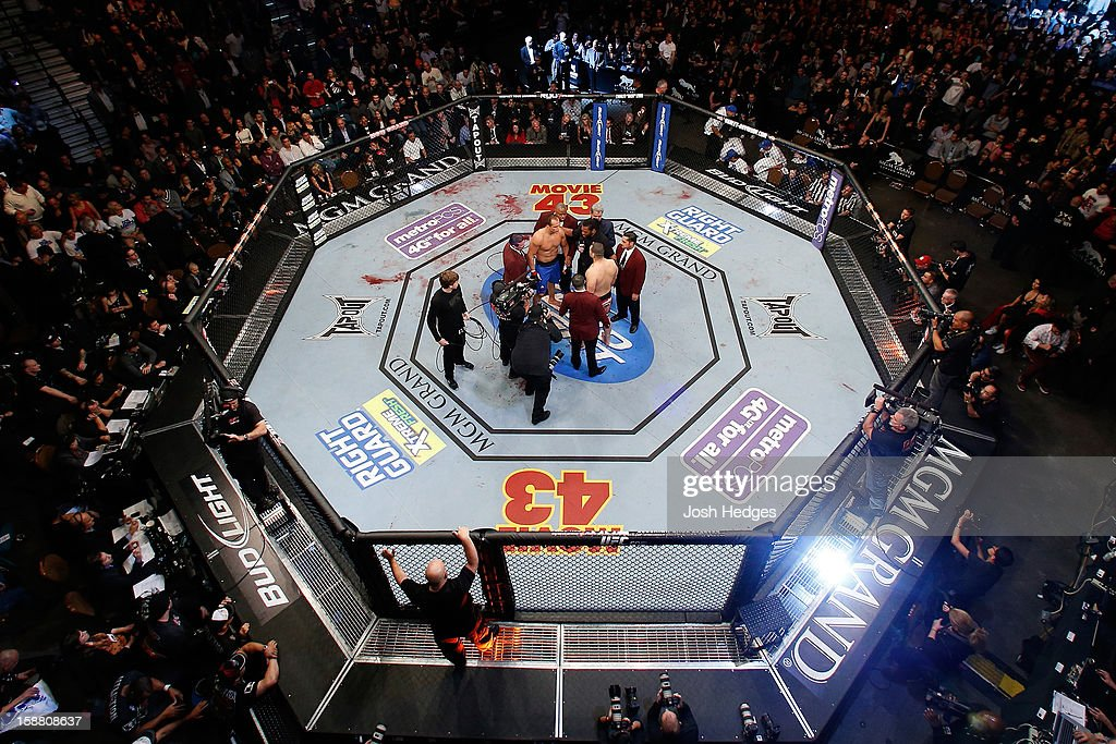 An overhead view of the Octagon as Junior dos Santos and Cain Velasquez receive final instructions from referee Herb Dean before their heavyweight championship fight at UFC 155 on December 29, 2012 at MGM Grand Garden Arena in Las Vegas, Nevada.