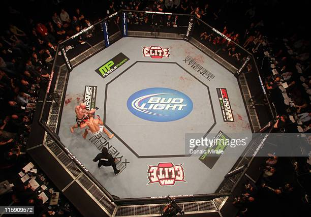 An overhead view of the Octagon as Junior Dos Santos battles Shane Carwin at UFC 131 at Rogers Arena on June 11 2011 in Vancouver British Columbia...