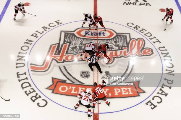 An overhead view of the opening face off for the 2017 Kraft Hockeyville Canada game between the New Jersey Devils and Ottawa Senators at Credit Union...