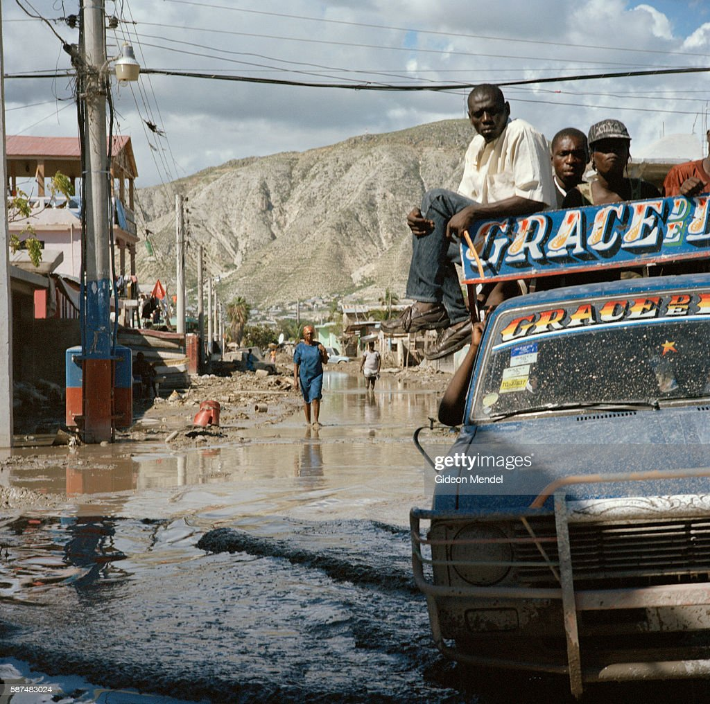 An overloaded vehicle struggles through a junction in the centre of Gonaives two weeks after it was flooded during Hurricanes Ike and Hanna Most of...