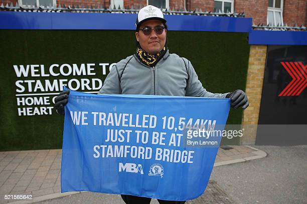 an overseas Chelsea supporter holds a message on a flag prior to the Barclays Premier League match between Chelsea and Manchester City at Stamford...