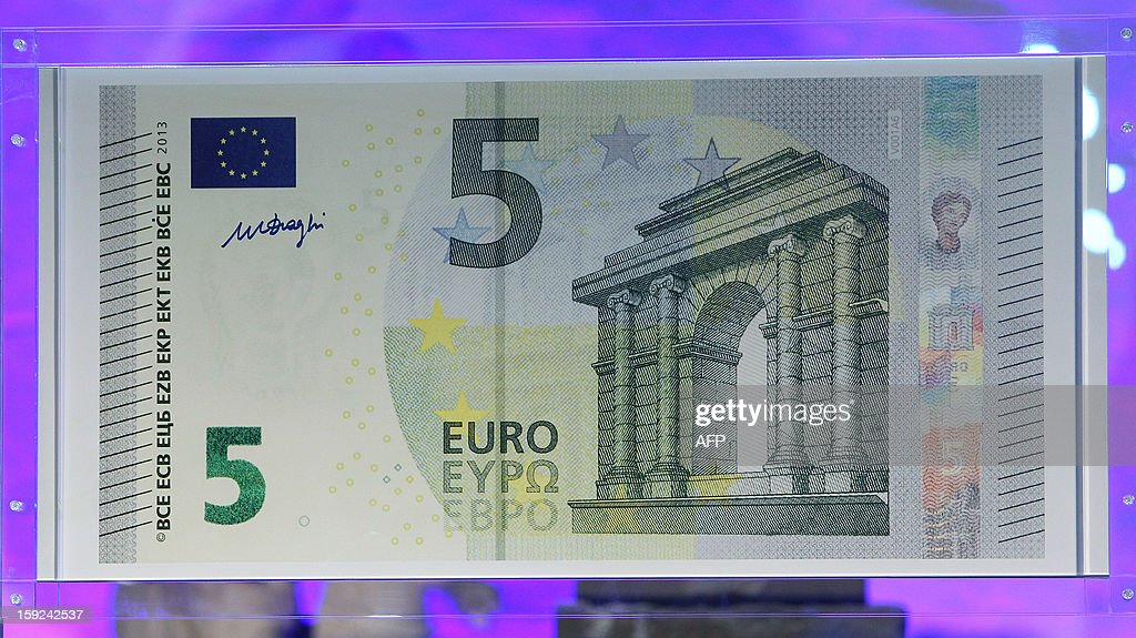 An oversized 5 EUR banknote is displayed at the European Central Bank, (ECB) during its unveiling ceremony in Frankfurt/Main, on January 10, 2013.
