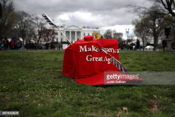 An oversized replica of a 'Make America Great Again' hat sits on the grass across from the White House during a demonstration against the Dakota...