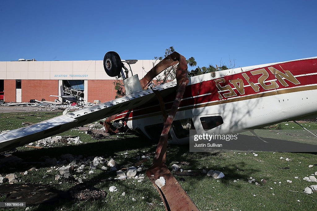 An overturned airplane at the Canadian Valley Technology Center sits amidst rubble after it was damaged by a series of tornadoes that ripped through the area a day earlier on June 1, 2013 in El Reno, Oklahoma. A series of tornadoes ripped through the area on Friday evening killing at least nine people, injuring many others and destroying homes and buildings.