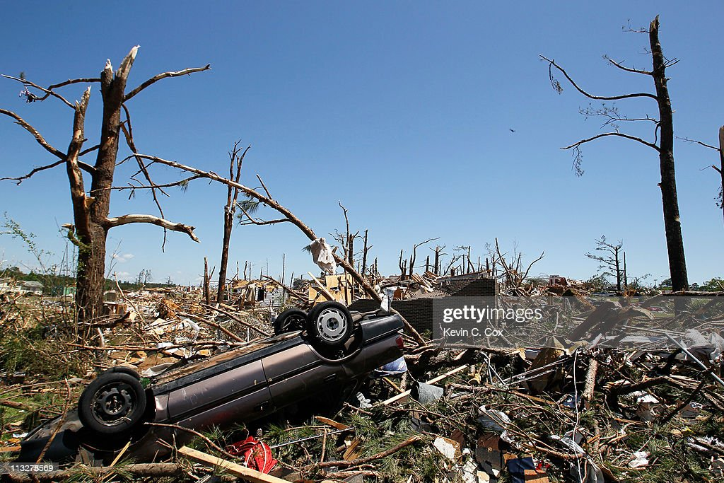 An overturned car rests next to the debris of a home destroyed by tornadoes on April 29, 2011 in Pratt City, Alabama. Alabama, the hardest-hit of six states, is reported to have had nearly 300 deaths as a result of the storms.