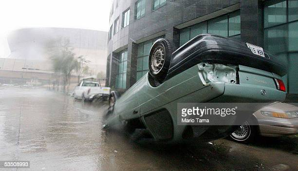 An overturned car sits in front of the Superdome in the aftermath of Hurricane Katrina August 29 2005 in New Orleans Louisiana Katrina made landfall...