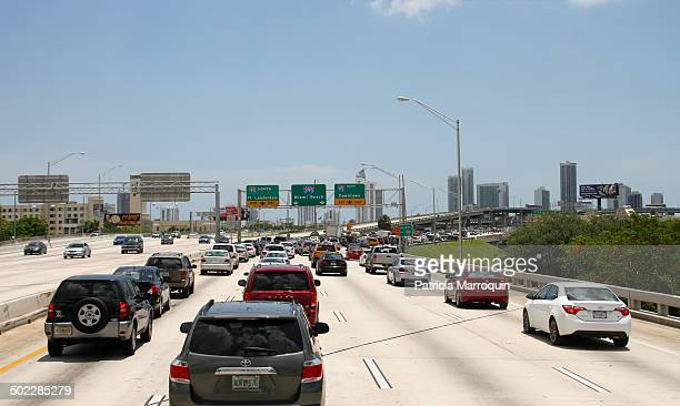 An overturned cement truck caused a traffic jam at the Interstate 95395 interchange in Miami Florida on June 21 2014