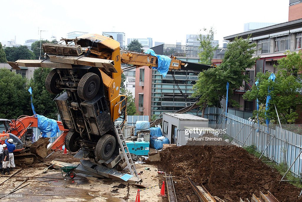 An overturned crane vehicle is seen whose arm hitting the room of a special nursing home for aged on October 4, 2010 in Tokyo, Japan. No one injured with this accident.