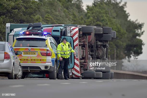 An overturned lorry causes the A1 road to be closed in both directions on February 16 2016 in Torness Scotland Two HGVs have been blown over by high...