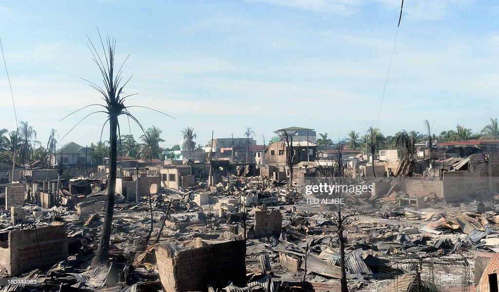 An overview of destroyed houses gutted by fire at the height of firefight between government forces and Muslim rebels in Zamboanga City on the southern island of Mindanao on September 13, 2013, as the stand-off entered its fifth day. Philippine President Benigno Aquino on September 13 visited the southern city of Zamboanga where government troops are battling followers of a Muslim rebel leader opposed to peace talks.