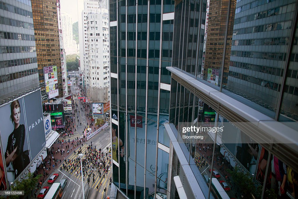 An overview of the Causeway Bay shopping district shows pedestrians crossing a street in Hong Kong, China, on Monday, March 4, 2013. Hysan Development Co. is scheduled to release earnings on March 6. Photographer: Lam Yik Fei/Bloomberg via Getty Images