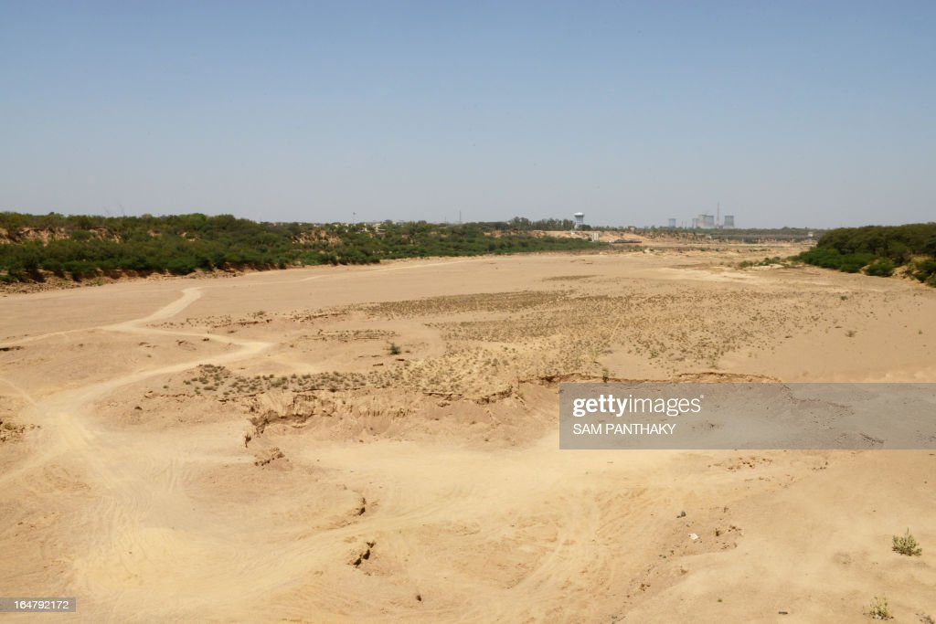 An overview of the dry Sabarmati river near Gujarat's capital, Gandhinagar on March 28, 2013. In recent decades, rising temperatures and higher humidity reduced labour capacity, on paper at least, by 10 percent during the hottest months. AFP PHOTO / Sam PANTHAKY