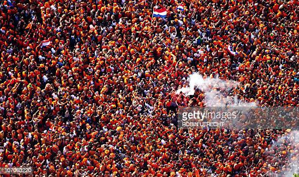 An overview of The Netherlands football team fans dressed in orange gathered at Amsterdam's Museum Square to watch the match on giant screens and in...