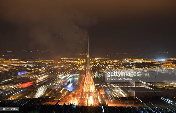 An overview of the site using a long exposure as thousands of people gather to watch the Temple by renowned Burning Man artist David Best set ablaze...