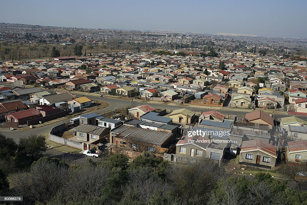 An overview of traditional small houses on August 11 2006 in Soweto Johannesburg South Africa Most people live in these types of houses Soweto is...